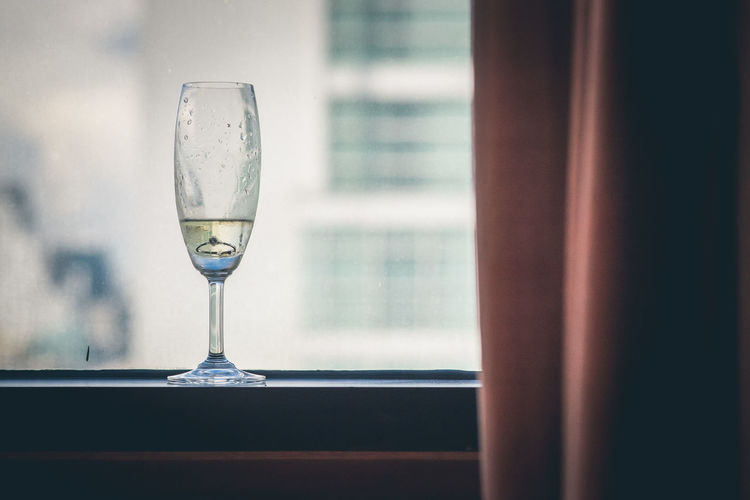 Close-up of wine glass window
