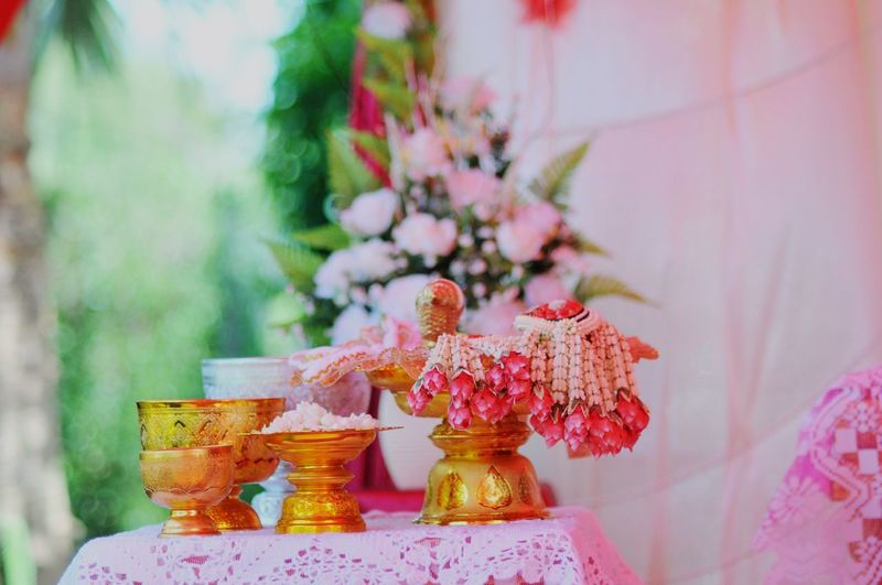 Flower arrangement in Thai wedding Flowers Garland Garland Flower Arrangement Malai Gold Wedding Thai Religion No People Focus On Foreground Spirituality Statue Human Representation Celebration Flower Close-up