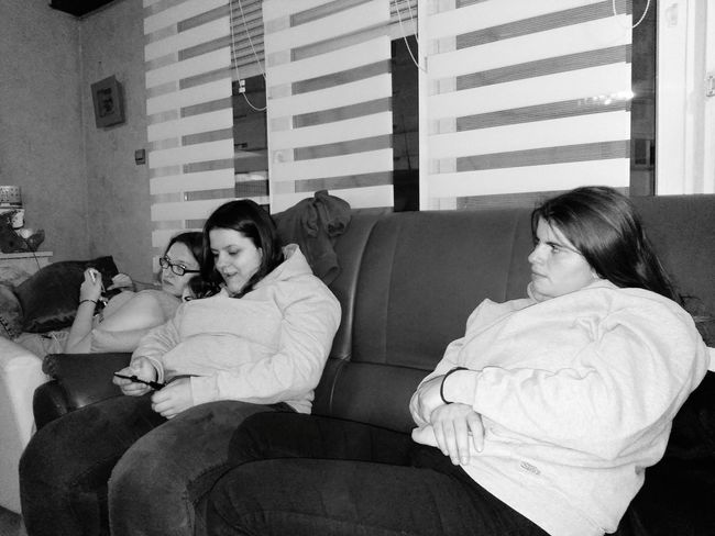 Young Women Sitting Living Room Women Togetherness Domestic Life Females Men Warm Clothing Relaxation