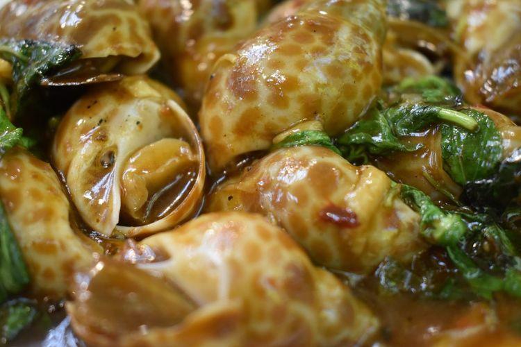 Full frame shot of snails in plate