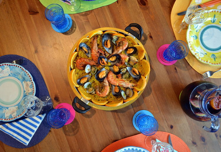 Colors Food And Drink Paella Seafood Ceramics Close-up Day Directly Above Drinking Glass Food Food And Drink Freshness Healthy Eating Healthy Food Healthy Lifestyle High Angle View Indoors  No People Paella De Marisco Plate Ready-to-eat Table