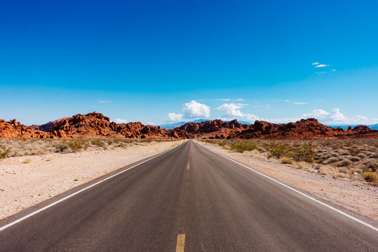 Country Road Desert Landscape Long Mountain Nature Non-urban Scene Outdoors Road Road Marking Surface Level Vanishing Point