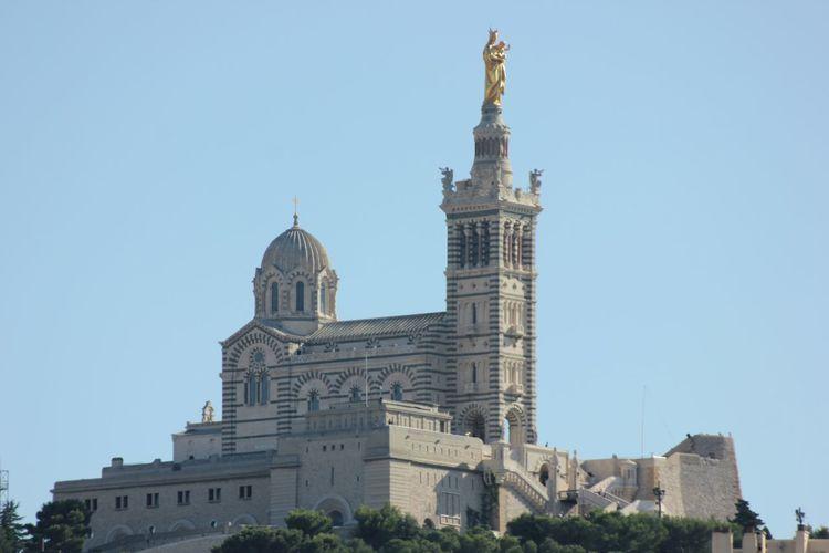 Low angle view of notre-dame de la garde against clear blue sky