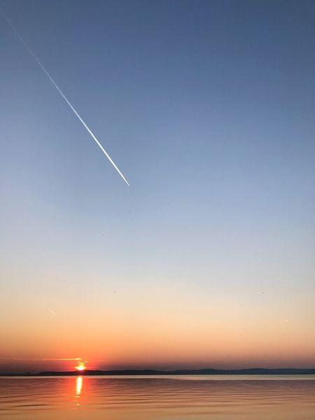 sunset at lake Balaton Balaton Nature Scenics Clear Sky Beauty In Nature Outdoors Tranquil Scene Vapor Trail Tranquility No People Airplane Sky Contrail Day Lake Balaton Hungary IPhone