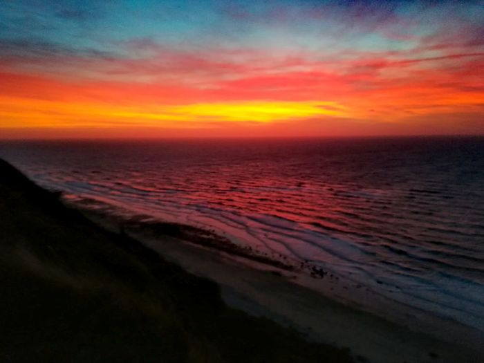 Water Sea Multi Colored Sunset Wave Beach Red Orange Color Sky Horizon Over Water Tide View Into Land Atmospheric Mood Coast Sky Only Seascape Romantic Sky Dramatic Sky Coastal Feature Wide Shot Rainbow Low Tide Marram Grass Moody Sky Forked Lightning Surf