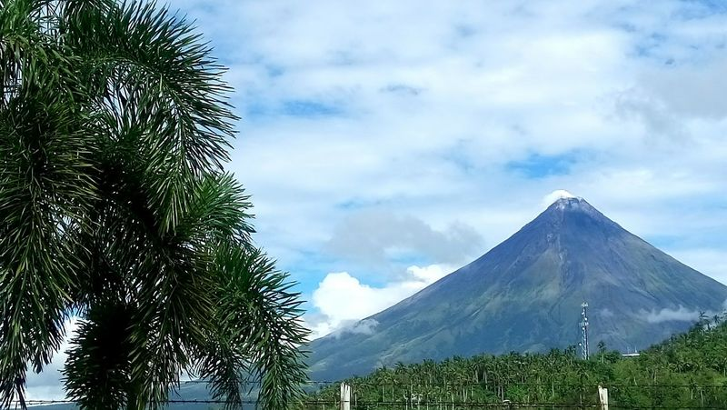 At last! The beautiful Mayon Volcano came out behind the clouds! Mountain Cloud - Sky Nature Landscape Beauty In Nature Travel Destinations Outdoors Sony Xperia C5 Photography Sony Xperia Photography Vacation Travel Albay Bicol, Philippines Bicolandia Philippines Eyeem Philippines Vacations Travel Photography Beauty In Nature Nature