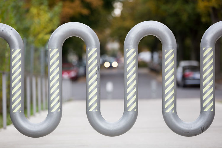 Meandering barrier at a park entrance Architecture Barricade Boundary City Close-up Closed Connection Curve Entrance Focus On Foreground Gate Metal Metallic No People Outdoors Pattern Protection Safety Security Barrier Selective Focus Shape Single Object Street Striped Pattern Wave Pattern The Architect - 2017 EyeEm Awards