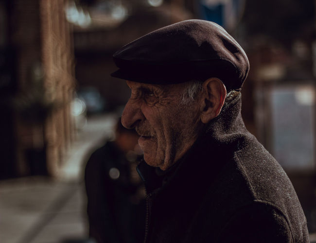 Camera - Canon 550D - Lens - 50 mm f/1.8 Blog : https://www.instagram.com/david_sarkisov_photography/ One Person Portrait Headshot Clothing Hat Adult Senior Adult Males  Looking Focus On Foreground Men Senior Men Facial Hair City Real People Looking Away Lifestyles Beard Contemplation Mature Men Outdoors EyeEm Best Shots EyeEm Selects My Best Photo Portrait Photography Moms & Dads Streetwise Photography
