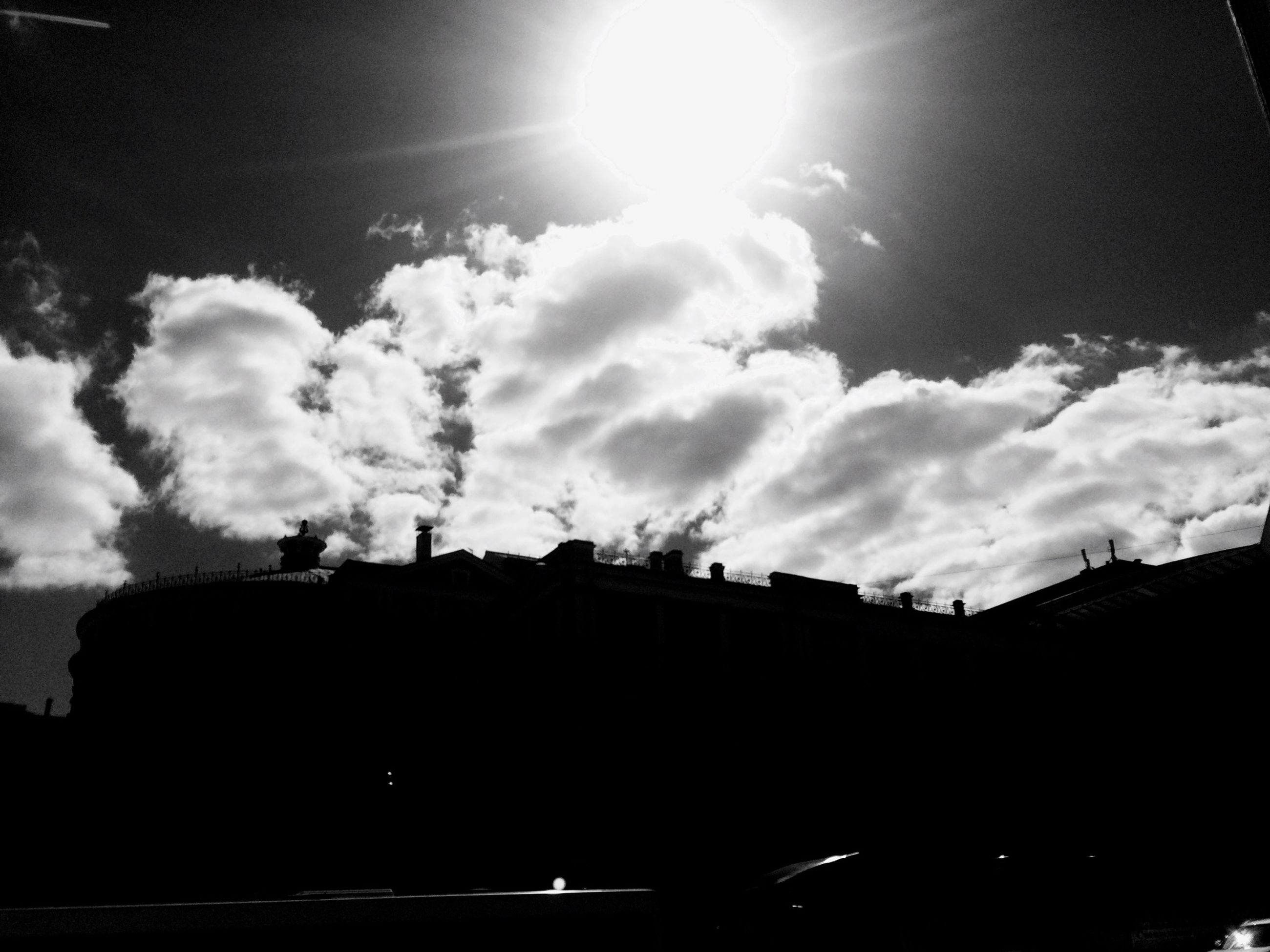 building exterior, architecture, built structure, low angle view, sky, sun, sunbeam, silhouette, sunlight, lens flare, cloud - sky, building, cloud, city, street light, outdoors, house, residential building, no people, sunny