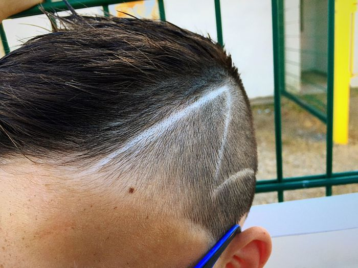Close-up of boy with stylish hairstyle