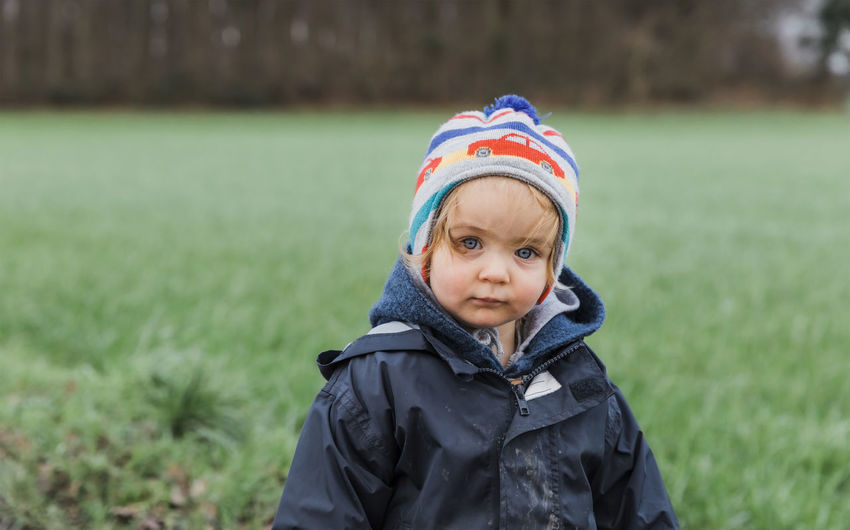 Toddler girl portrait in front of field – Kempen, Germany Baby Babyhood Babygirl Babies Only Beauty Blank Expression Blond Hair Blond Hair And Blue Eyes Blue Eyes Casual Clothing Caucasian Cheerful Close-up Coat Confidence  Contemplation Curiosity Cute Daydreaming Dreaming Dirty Muddy Messy Facial Expression Face Faces Of EyeEm Human Face Field Germany Girl Girls Females Happiness Happy Head And Shoulders Jacket Healthy Lifestyle People Rural Scene Sad Sadness Depression - Sadness Serious Standing Staring Toddler  Toddlerlife Waist Up Watching Tree Portrait Clothing One Person Headshot Front View Warm Clothing Looking At Camera Day Winter Child Plant Focus On Foreground Childhood Nature Knit Hat Hat Leisure Activity Grass Outdoors Innocence Scarf Hood - Clothing