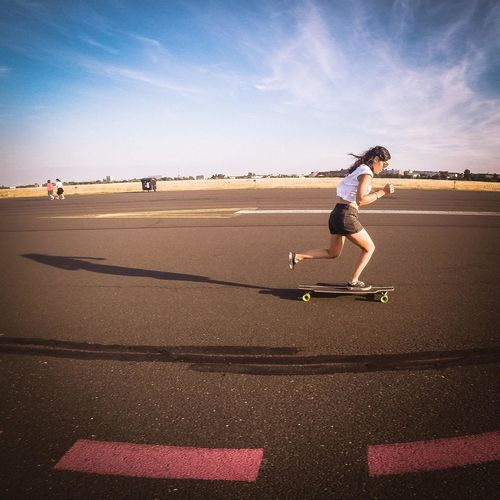 flying away from shadows Skate Photography: Same Tricks, New Perspectives Berlin Tempelhofer Feld Longboard Longboarding One Person Sunlight Sky Day Shadow Road Outdoors Lifestyles Sunlight Streetwise Photography International Women's Day 2019