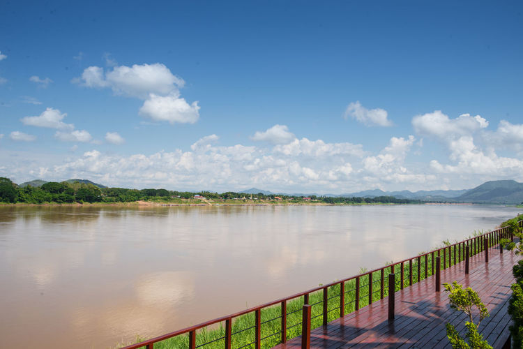 Chiang Khan : Loei, Thailand Sky Cloud - Sky Water Beauty In Nature Tranquil Scene Scenics - Nature Tranquility Nature Lake Reflection Day No People Plant Railing Outdoors Idyllic Tree Non-urban Scene Landscape