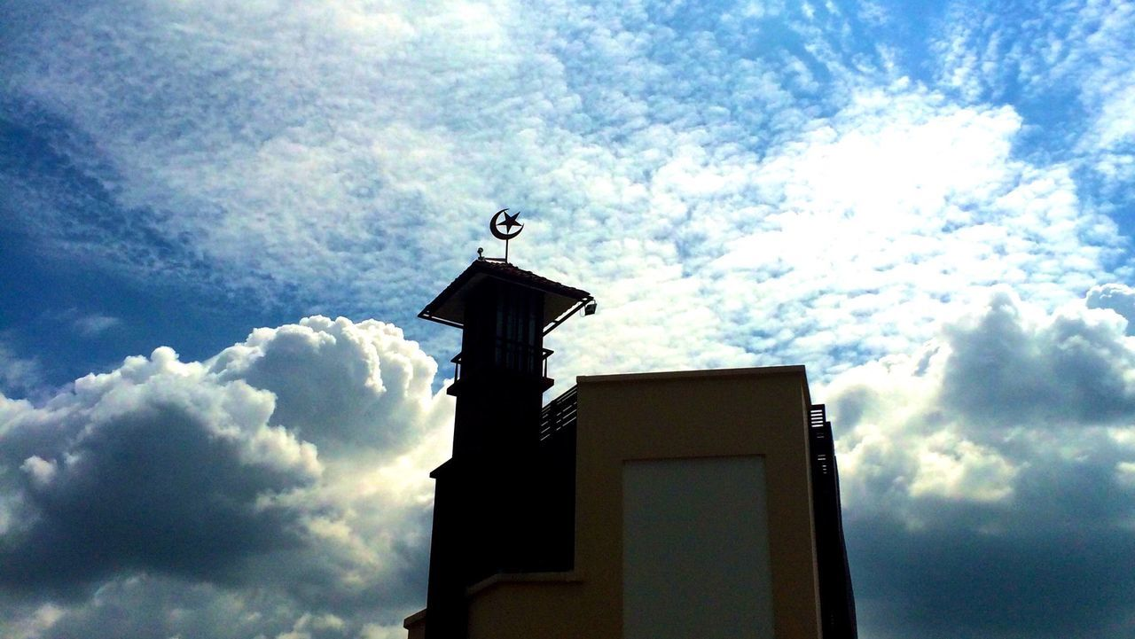 Low Angle View Of Masjid Ahmad Against Cloudy Sky