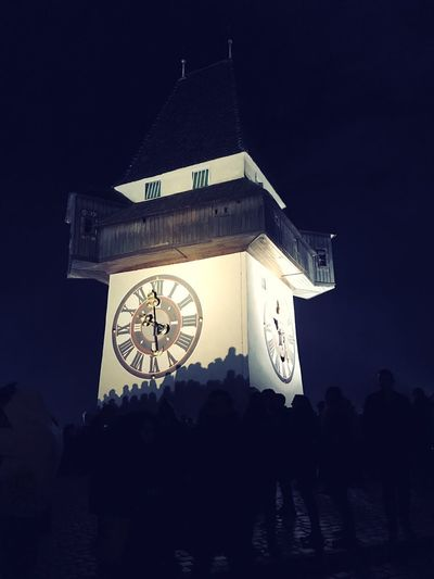 Clock Time Night Built Structure Architecture Clock Tower Low Angle View Building Exterior Clock Face Silhouette Illuminated Large Group Of People Roman Numeral Outdoors Sky Minute Hand Hour Hand Astronomical Clock Astronomy Men