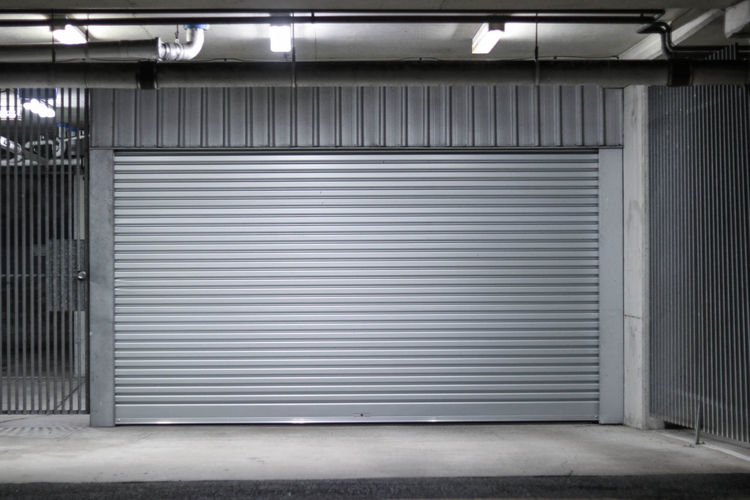 Garage roller door Aluminum Architecture Closed Corrugated Iron Door Entrance Garage Metal No People Silver Colored Steel Storage Compartment Wall - Building Feature