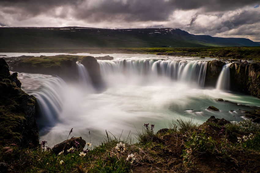 Goðafoss, Iceland Beauty In Nature Blurred Motion Cloud - Sky Environment Falling Water Flowing Flowing Water Forest Land Long Exposure Motion Nature No People Outdoors Plant Power In Nature Scenics - Nature Sky Travel Destinations Tree Water Waterfall