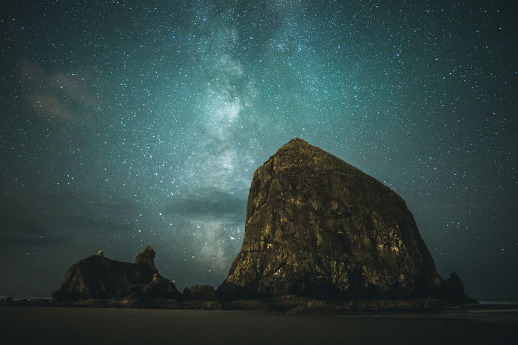 Milky Way Galaxy over Haystack Rock in Cannon Beach, Oregon, USA. Perspectives On Nature Astronomy Beauty In Nature Constellation Galaxy Geology Long Exposure Milky Way Milkyway Nature Night No People Outdoors Rock - Object Rock Formation Scenics Sky Star - Space Stars Tranquil Scene Tranquility
