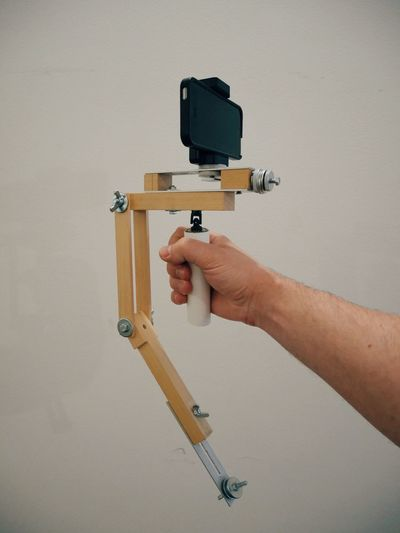 Built myself an iPhone steady cam from scrap for eyeem videography :) not much of a design approach but works quite nicely once balanced out . Human Hand Holding Steadycam DIY Make It Yourself Designer  Getting Creative Videographer Built Structure