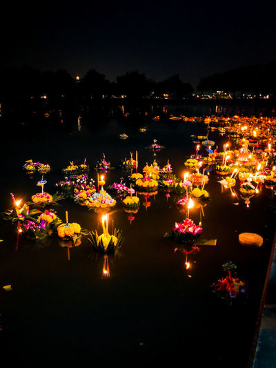Candle Celebration Illuminated Burning Night Flame Large Group Of Objects No People Heat - Temperature Outdoors Sky Diwali Diya - Oil Lamp Krathong Festival River Pray Beauty In Nature Backgrounds