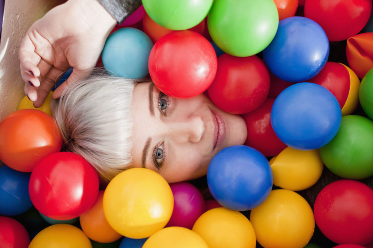High angle portrait of woman with colorful balloons