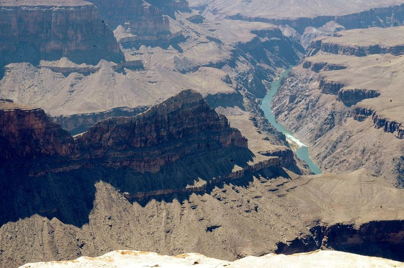 High Angle View Of River Amidst Rocky Mountains At Grand Canyon National Park