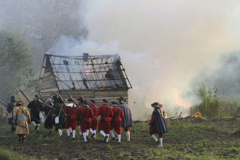 Rear view of men standing against sky