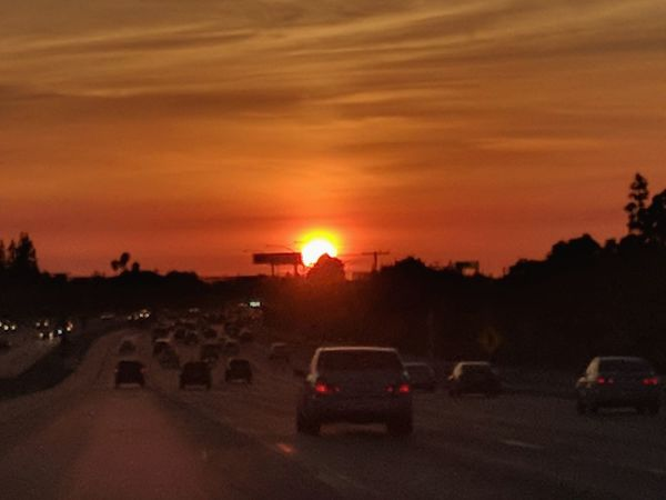 on a california highway in the sun.. SoCal Taking Photos Early Evening Golden Hour Golden Sunset In A Car On The Road Sunset Car Dramatic Sky Landscape Cloud - Sky Outdoors Sky