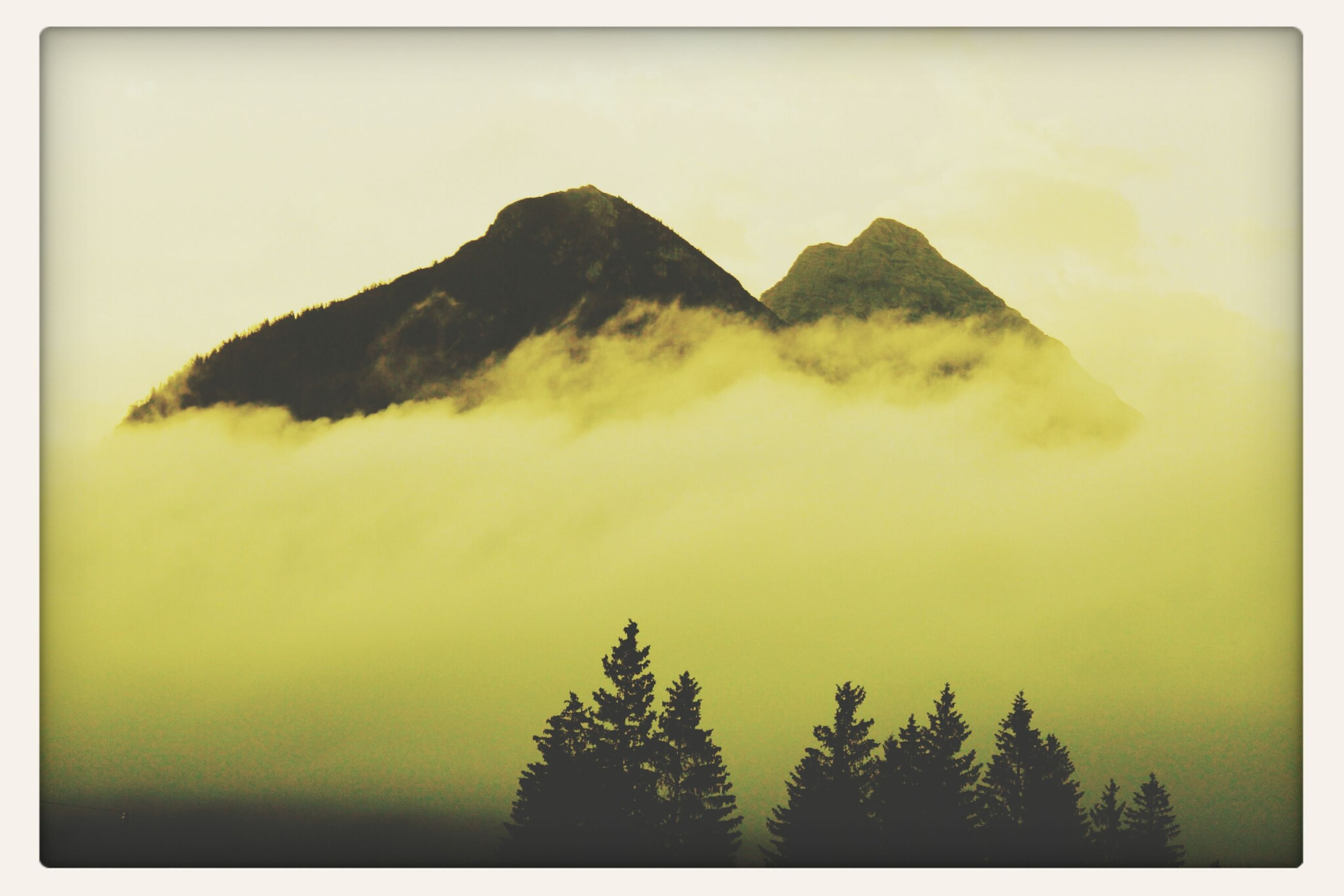transfer print, tranquil scene, scenics, mountain, tranquility, beauty in nature, auto post production filter, nature, sky, tree, idyllic, mountain range, water, non-urban scene, no people, outdoors, landscape, majestic, remote, day