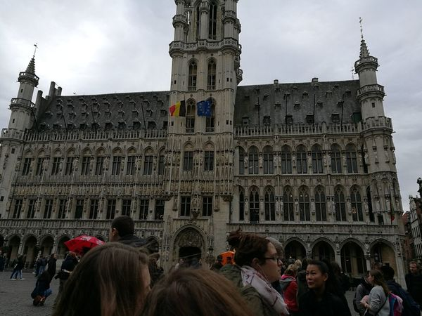Belgium♡ Grand Place Bruxelles Travel Destinations History Built Structure Large Group Of People Tourism Outdoors Flag Day Clock Tower Adult City Politics And Government Adults Only Sky People