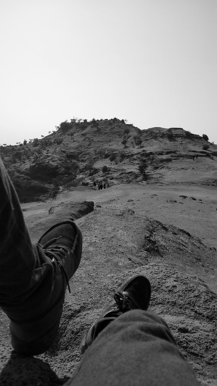 LOW SECTION OF MAN RELAXING ON LAND