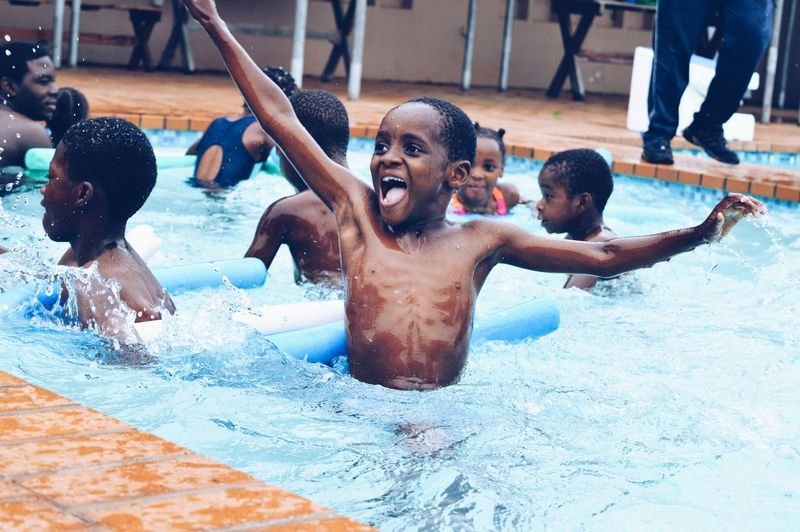 Enjoy The New Normal Swimming Pool Happiness Friendship Cheerful Togetherness Splashing Water Smiling Summer Fun Outdoors Orphanage Mozambique Childhood Young And Free Fresh On Eyeem  Live For The Story Sommergefühle Summer Exploratorium Summer Exploratorium The Portraitist - 2018 EyeEm Awards