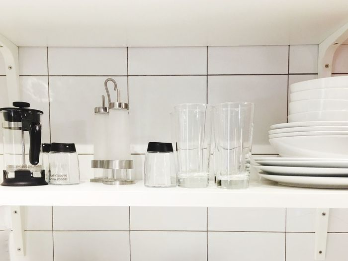 Indoors  Domestic Room Household Equipment No People Kitchen Arrangement In A Row Still Life Empty Absence Large Group Of Objects White Color Stack Shelf Side By Side Group Glass Kitchen Counter Domestic Kitchen