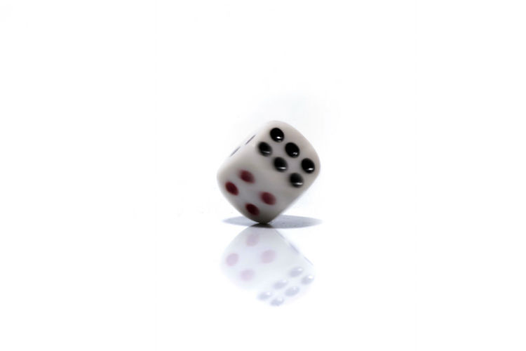 Rolling White dice isolated on white background Arts Culture And Entertainment Close-up Copy Space Cube Shape Cut Out Dice Gambling Game Of Chance High Angle View Indoors  Leisure Activity Leisure Games Luck No People Number Opportunity Relaxation Spotted Studio Shot White Background White Color