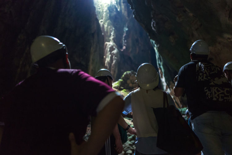 Kuala Lumpur Batu Caves Adventure Darkcave Day Headwear Large Group Of People Men Nature Outdoors People Real People Rear View Standing Togetherness