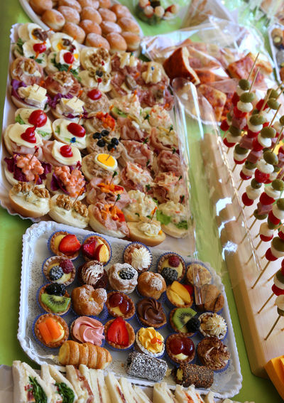 abundant buffet with many trays filled with sweet pastries and filled sandwiches Buffet Time Many People Meal Sandwich Sandwiches Abundance Brunch Buffe Buffet Buffet Dinner Buffet Food Buffetlunch Catering Catering Service Food Foods Full Frame Full Length Many Many Colors Pastries Pastry Sandwich Time Sweety  Trays