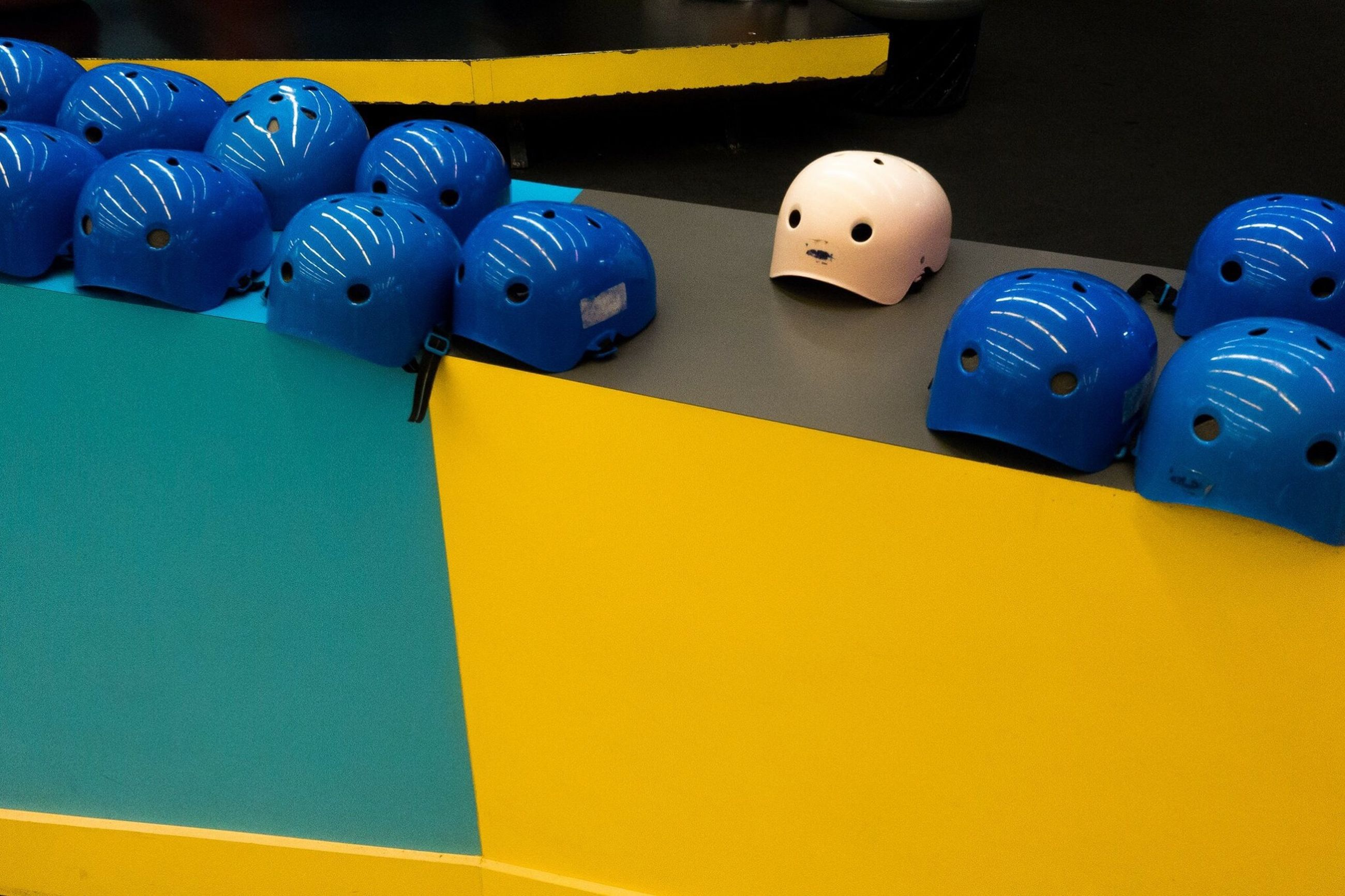 indoors, multi colored, blue, still life, yellow, variation, close-up, high angle view, copy space, in a row, technology, no people, large group of objects, table, leisure games, equipment, choice, wall - building feature, man made object, colorful