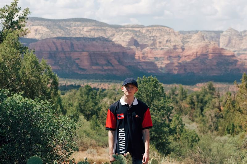 Hiking tour Beautiful Desert Norway Mountain Sedona Go Explore Plant Mountain One Person Beauty In Nature Real People Front View Tree Clothing Nature Growth Sky Men Scenics - Nature Outdoors