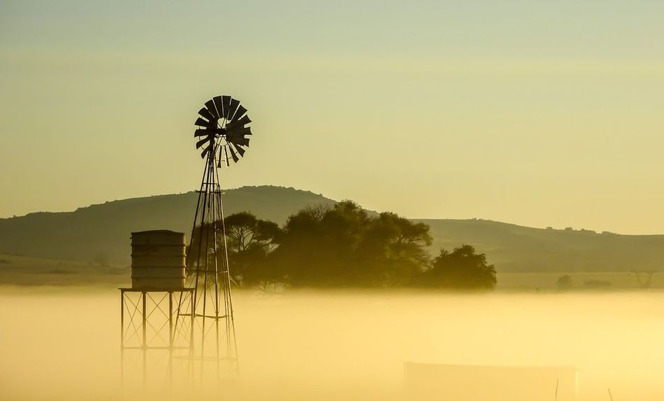 South Africa Mist Golden Hour Wind Pump Alternative Energy Environmental Conservation Wind Power Renewable Energy Landscape No People Scenics Tranquility Shades Of Winter An Eye For Travel