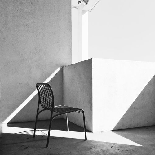 Empty Chair At Building Terrace