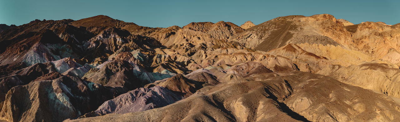 Artist's Palette 🎨 🎨 🎨 Panoramic wide angle shot of the bizarre colorful landscape, Death Valley National Park, California, USA. Submitted to the Stay Out mission: A perfect Stay Out moment because this landscape is extremely inspiring and unique. It is the phenomenal combination of erosion, weather, geology, salts and metals which makes this colorful place feel so elemental. Stay Out Eroded Climate Formation Travel Destinations Travel No People Non-urban Scene Geology Physical Geography Rock Formation Landscape Mountain Range Rock Death Valley Death Valley National Park Artists Palette Artists Drive Sunlight Colors Colorful California Panorama High Resolution Wide Angle Dramatic Roadtrip Discover  Places Adventure Desert Desert Landscape Iconic Landmark Discover Places Natural Wonders Extreme Terrain Minerals Unique Oxidation Volcanic  Gravel Deposit Erosion Salt - Mineral Metals Elemental Combination Hiking Trail