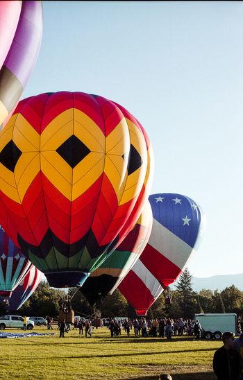 Multi colored hot air balloon against clear sky