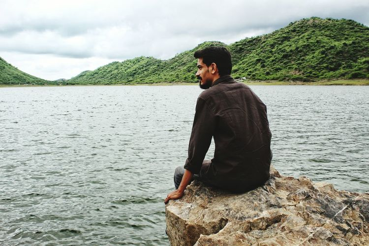 EyeEm Selects One Man Only Cloud - Sky Only Men One Person Vacations Udaipur Lake Side Lake Nature Beard Portrait Sky Lost In The Landscape