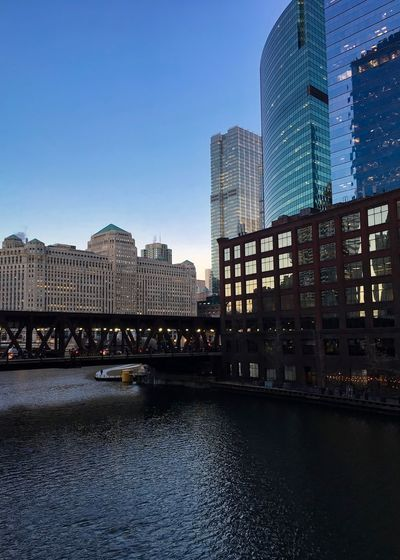 Evening sunset in winter reflects over Chicago River and Lake Street's elevated track. Chicago Chicago River Chicago Riverwalk Chicago Loop Cityscape Downtown Chicago Elevated Track Reflection Architecture Bridge - Man Made Structure Building Exterior Buildings Built Structure City Day Elevated Road Modern Outdoors Reflective Glass Architecture Riverfront Sky Skyscraper Tower Water Waterfront