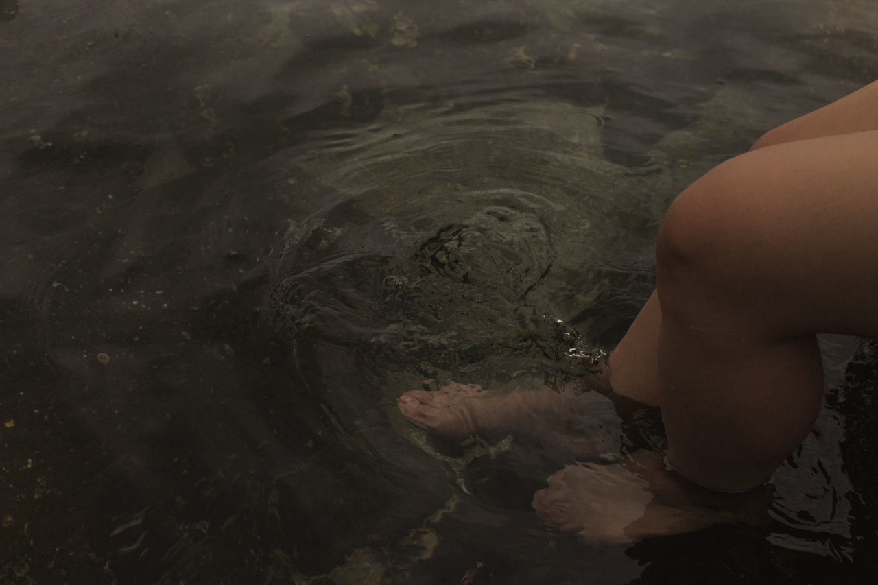LOW SECTION OF CHILD ON WATER