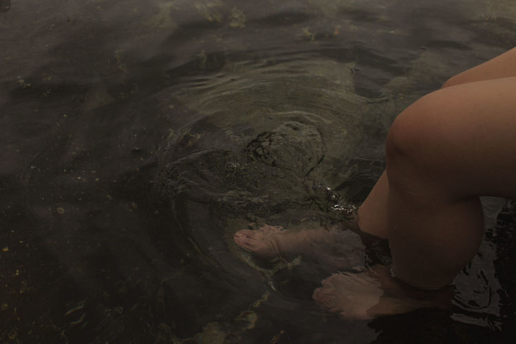 Low section of boy in water