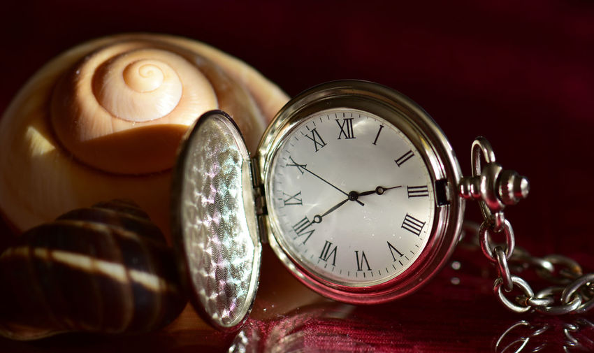 Close-up of pocket clock on table