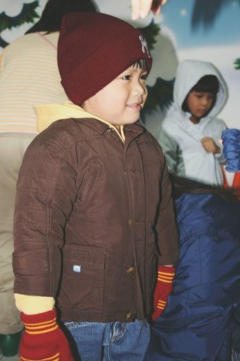 Close-up of smiling cute boy wearing warm clothing