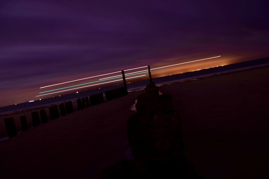 Architecture Beach Beauty In Nature Built Structure Cloud - Sky Illuminated Nature Night No People Outdoors Scenics Sea Sky Sunset