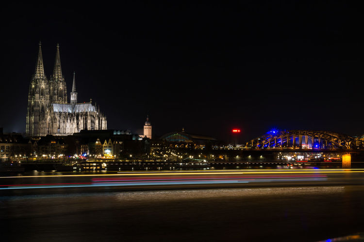 Light trails on city buildings at night